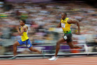 Jamaica's Usain Bolt, right, and Ecuador's Alex Quinonez compete in a men's 200-meter semifinal. Photo / AP.