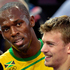 Jamaica's Usain Bolt, left, waits with France's Christophe Lemaitre after their men's 200-meter semifinal. Photo / AP.