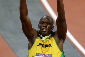 Usain Bolt from Jamaica celebrates after winning Gold in the Men's 100m Final. Photo / AP