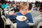 Ethan Hope, 10, from Gladstone Primary School in Auckland, tucks in as part of a record breakfast-eating attempt yesterday. Photo / Greg Bowker