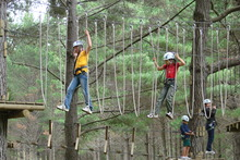 Young and old alike enjoy learning the ropes at Woodhill Forest. Photo / Supplied