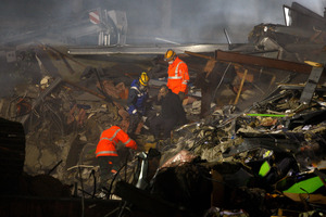 Emergency services search the rumble for survivors of the collapsed CTV building after the earthquake. Photo / Brett Phibbs