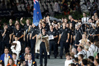 Nick Willis leads the New Zealand team into Olympic Stadium.