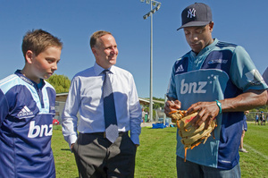John Key, shown with Max and NY Yankees player Curtis Granderson, will watch his son play in the US. Photo / David Rowland