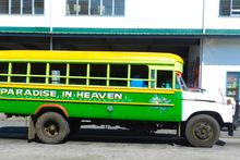 One of the many brightly painted buses of Samoa. Photo / Dan Ahwa