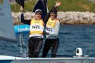 Olivia Powrie and Jo Aleh win gold at the Olympic Games women's 470 dinghy sailing.  Photo / Mark Mitchell