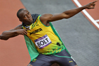 Usain Bolt does his trademark celebration after winning gold in the men's 100m final. Photo / Brett Phibbs
