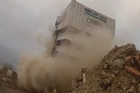 A 14-story office tower in Christchurch tumbled to the ground in just a few seconds during New Zealand's first controlled implosion.