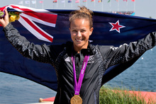 New Zealand kayaker Lisa Carrington celebrates after winning the gold medal in the final of the women's 200-metre K-1 canoe sprint. Photo / Brett Phibbs NZ Herald