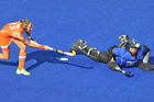 Black Sticks goalkeeper Bianca Russell saves a shot from Netherlands Maartje Paumen during their semifinal penalty shootout. Photo / Brett Phibbs
