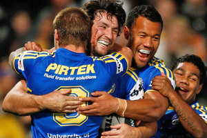 Eels players celebrate after scoring one of six tries against the Roosters. Photo / Getty Images
