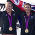 Olivia Powrie and Jo Aleh after receiving their gold medals for winning the women's 470 dinghy sailing. Photo / Mark Mitchell
