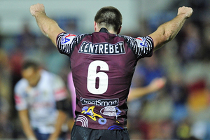 Kieran Foran raises his arms in celebration after his side beat the Cowboys. Source / Getty Images