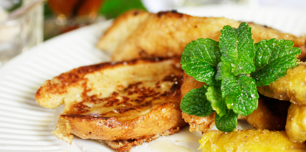 Coconut French toast with fried bananas. Photo / Michael Craig