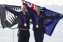  New Zealand's Jo Aleh, left, and Olivia Powrie jubilant after receiving the gold medal for the Olympic Games women's 470. Photo / Mark Mitchell
