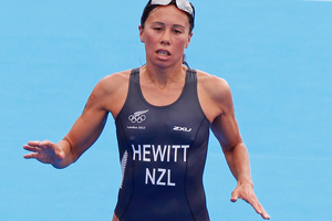 The fast pace in the run took its toll on New Zealand's Andrea Hewitt who came sixth in the triathlon. Photo / Mark Mitchell