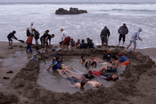 Take a spade to the Coromandel's Hot Water Beach and dig your own hot pool.  Photo / Greg Bowker