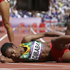 Ethiopia's Genzebe Dibaba lies on the track after competing in a women's 1500-meter heat during the athletics in the Olympic Stadium at the 2012 Summer Olympics, London, (AP Photo/Anja Niedringhaus)