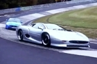 Jaguar's anti-social supercharged XKR-S gives chase to the ageing XJ220 supercar around Nurburgring Nordshliefe.
