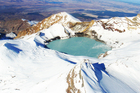 Mt Ruapehu's crater lake stands out like a jewel. Photo / Jared Savage