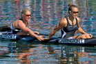 Kayakers Erin Taylor and Lisa Carrington react after finishing last in the K2 500m final. Photo / Brett Phibbs