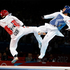 Martin Stamper, of Great Britain and Erick Osornio Nunez , Mexico, during their preliminary round in the Olympic Games 68-kg taekwondo. Photo / Mark Mitchell
