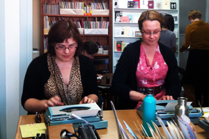 Letter writers using typewriters and rubber stamps, at Alphabet City in Mt Eden. Photo / Richard Robinson