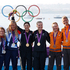 Gold medallists Jo Aleh and Olivia Powrie, with silver medallists Hannah Mills and Saskia Clark, and bronze winners Lisa Westerhof and Lobke Berkhout, during the victory ceremony. Photo / Mark Mitchell