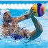 Andrija Prlainovic of Serbia, heads backwards as he attempts to pass the ball under pressure from Maurizio Felugo of Italy. Photo / AP