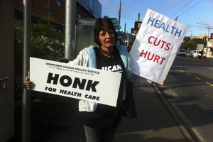 A protester outside Wellington Hospital today. Photo / APNZ