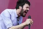 Michael Angelakos from Passion Pit performs at the Lollapalooza. Photo / AP