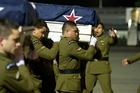 Two grieving families watched from a dimly-lit runway as the bodies of Lance Corporals Pralli Durrer and Rory Malone arrived home to New Zealand.