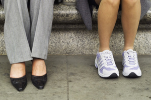 Teaming workwear with sneakers has been voted the biggest shoe faux pas. Photo / Thinkstock