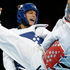 Turkey's Nur Tatar (blue) fights South Korea's Hwang Kyung-seon during the gold medal match. Photo / AP