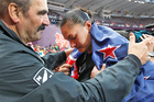 Valerie Adams in despair with her coach, Jean-Piere Egger, after her last throw. Photo / Mark Mitchell