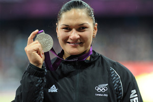 Valerie Adams holds her silver medal after the medal ceremony for the women's shot put. Photo / Brett Phibbs