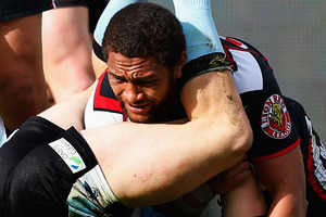 Manu Vatuvei of the Warriors is caught between the legs of Nathan Stapleton of the Sharks during the round 22 NRL match. Photo / Getty Images.