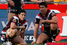 Kevin Locke and Elijah Taylor react during the Warriors' heavy defeat to the Sharks on Sunday. Photo / Getty Images