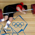 Matthias Steiner of Germany gets hit by the weights while failing to make a successful lift in the men's over 105-kg, group A, weightlifting competition in London. (AP Photo/Ng Han Guan)