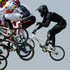 Marc Willers (back) in action in the semi-final of the Men's Cycling BMX. Photo / Brett Phibbs