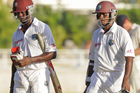 Kemar Roach, left, and Shivnarine Chanderpaul guided West Indies to victory. Photo / AP