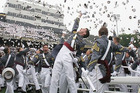 At graduation, tried-and-tested cadets toss their hats in the air.