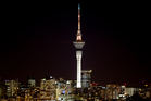 The Auckland Sky Tower is lit gold to celebrate Valerie Adams being awarded the Gold Medal at the 2012 London Olympics. Photo / Richard Robinson.