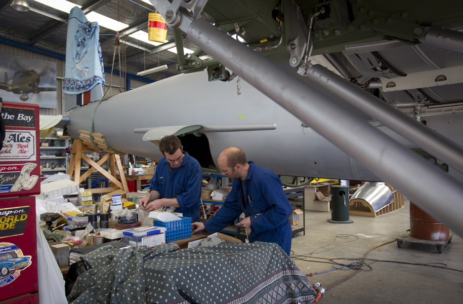 Andy Hosking and Paul Levitt work on the wooden de Havilland Mosquito restored by Warren Denholm's Avspecs team from 2005-2012.
