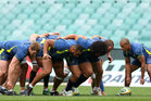 Wallaby forwards pack down a scrum during the Australian Wallabies Captain's Run at Etihad Stadium. Photo / Getty Images.