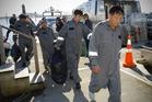 The rescued men come ashore at Mechanics Bay. Photo / Jason Dorday