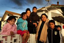 Te Rau Aroha Karakia with her family (left to right), Tiraha Karakia, 5, Te Rau Aroha Karakia, 7, Helen Haimona, holding Tatana Wharepapa, 2, Te