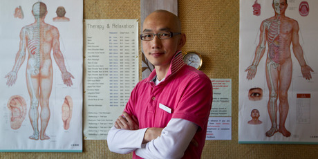Wayne Zheng, owner of Wayne Massage, says the $5 massages being offered at his outlets are aimed at introducing the Asian massage culture to Kiwis.  Photo / Richard Robinson
