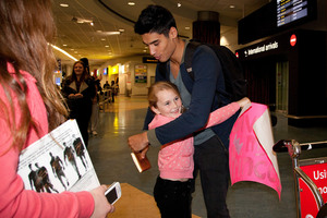 Siva Kaneswaran of British boy-band Wanted hugs a young fan. Photo / Neville Marriner