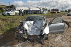 John Robinson's Mitsubishi was badly damaged on the road from Tauranga to Te Puke when two wheels came off the truck in front of him and hit the car, injuring Mr Robinson's back and legs. Photo / APN